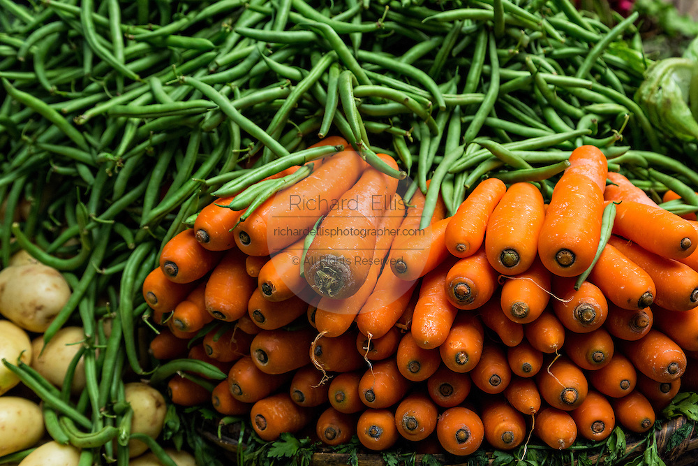 Fresh string beans and carrots at Benito Juarez market in Oaxaca, Mexico.