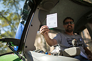 Farmer shows a votation ballot, Catalunya is forbade by the government of Spain voting in referendum for their independence Editorial and Commercial Photographer based in Valencia, Spain |Portraits, Hospitality, News, Sports, Media Coverage for Events
