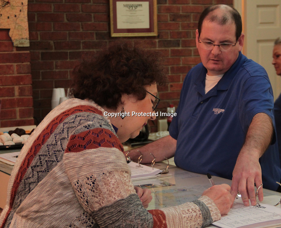 ADAM ARMOUR I BUY AT PHOTOS.ITAWAMBATIMES.COM<br /> Itawamba County Welcome Center employee John Adams helps Tuscaloosa, Alabama&rsquo;s Glenda Oswalt add her name to the center&rsquo;s guest log book. Her name was one of nearly 800 added to the book that day.