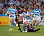 Gloucester, Great Britain, Argentina Wing, Santiago CORDERO, tackled by Giorgi TKHILAISHVILI, during the Argentina vs Georgia, Pool C. game. 2015 Rugby World Cup, Venue. Kingsholm Stadium. England, Friday - 25/09/2015 <br /> [Mandatory Credit; Peter Spurrier/Intersport-images]