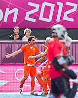 LONDEN - Robert van der Horst heeft de stand op 1-0 gebracht,maandag in de hockey wedstrijd tussen de mannen van Nederland en India tijdens de Olympische Spelen in Londen .ANP KOEN SUYK