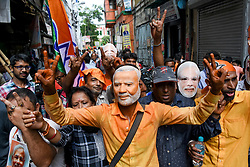May 23, 2019 - Kolkata, West Bengal, India - Supporters celebrate outside the BJP party office in Kolkata over the record win by Indian PM N. Modi, who has secured another five-year term after winning a landslide general election victory. More than 600 million people voted in a marathon six-week process. Mr Modi has not just exceeded exit poll predictions but has also won a larger share of the vote than the 2014 elections, partial results show. (Credit Image: © Debarchan Chatterjee/ZUMA Wire)