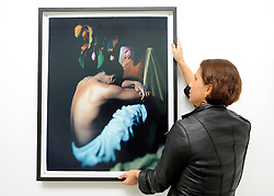 © licensed to London News Pictures. LONDON, UK.  22/06/11. Photographer Esther Teichmann positions one of her works from her 'Mythologies' series. Students present their work at The Royal College of Art's Fine Art Graduate Show 2011. The show runs from 24th June-3rd July 2011. Mandatory Credit Stephen Simpson/LNP