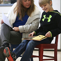 Lauren Wood | Buy at photos.djournal.com<br /> Volunteer Sherry Jenkins helps second grader Ethan McDonald read a book about snakes aloud Thursday morning at Joyner Elementary School.