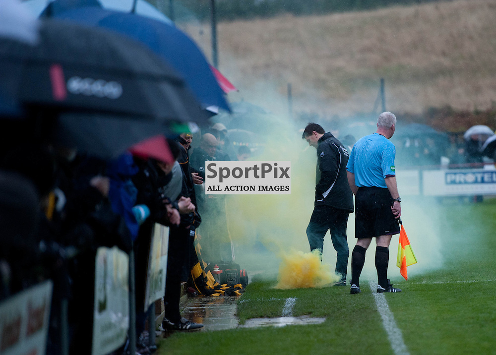 A smoke bomb is thrown onto the pitch at the start of the match. Culter FC v Berwick Rangers, William Hill Scottish Cup third round,  Crombie Park, Saturday 2 November 2013  (c) ANGIE ISAC | SportPix.eu