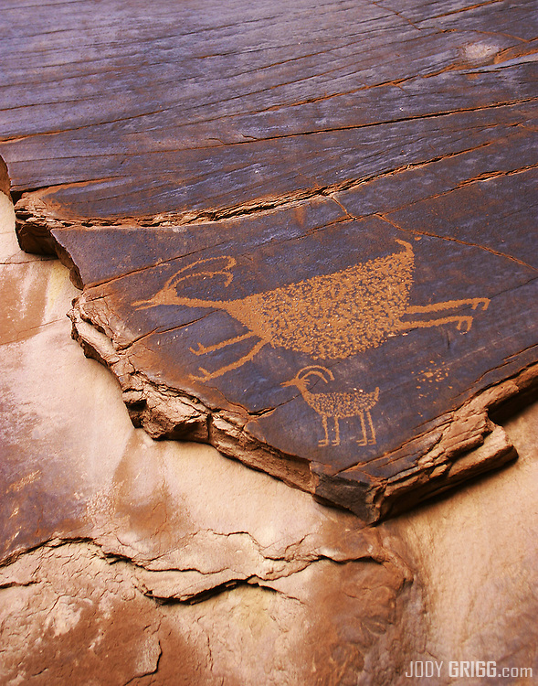 Ancient petroglyphs can be found in Monument Valley amongst the huge monolith rocks and mesas, Arizona.