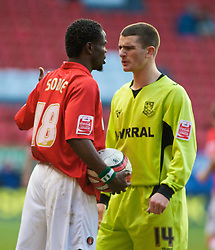 LONDON, ENGLAND - Saturday, January 30, 2010: Charlton Athletic's Sam Sodje and Tranmere Rovers' Terry Gornell square up to one another during the Football League One match at the Valley. (Photo by Gareth Davies/Propaganda)