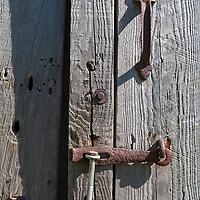 Barn board door with old door latch hardware.