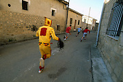El Colacho, the devil incarnate, chases the troublesome village youngsters, trying to hit them with his whip, during the Fiesta del Colacho, in Castrillo de Murcia, Burgos province, Spain. The Fiesta del Colacho is held every year at the time of the Catholic feast Corpus Christi.