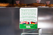 We accept payments in... Ready for the Eurozone collapse - old sign on baker shop fridge in Liege, Belgium, offering payments in several pre Euro currencies, including German Deutsche Marks, French Francs, and Dutch Guilders.