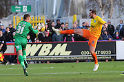 Ben Wilson (Goalkeeper) of AFC Wimbledon and Paul Hayes (Captain) of Wycombe Wanderers during the Sky Bet League 2 match between AFC Wimbledon and Wycombe Wanderers at the Cherry Red Records Stadium, Kingston, England on 21 November 2015. Photo by Stuart Butcher.