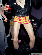 A man with his trousers round his ankles, wearing star covered Y-front pants, The Junk Club, Southend, UK 2006