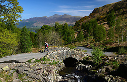 © Licensed to London News Pictures. 23/05/2015. Keswick, UK. A walker makes her way over Ashness Bridge near Keswick in the Lake District. Photo credit : Anna Gowthorpe/LNP