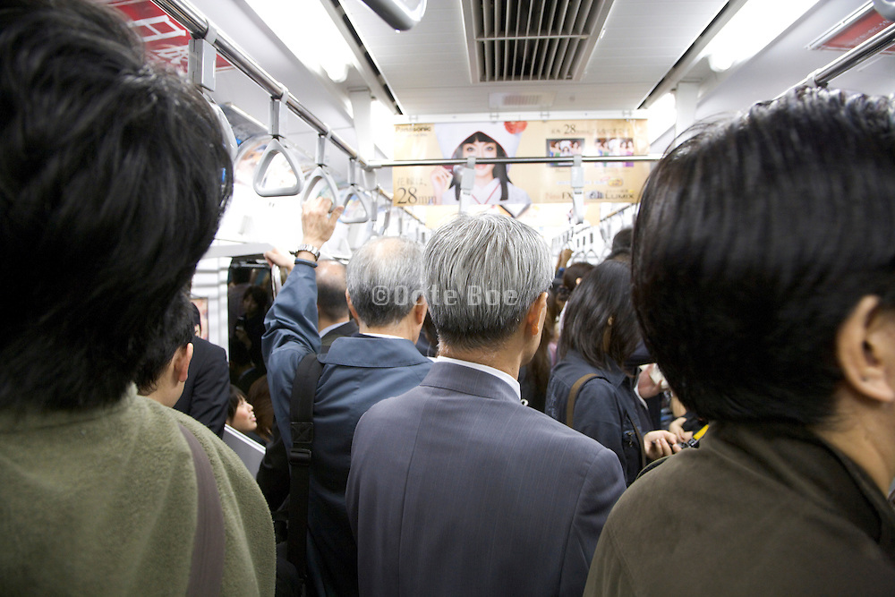 daily business commuters inside a train wagon compartment