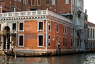 A gondolier navigates the canals of Venice.