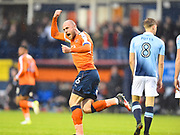Luton Town captain Scott Cuthbert celebrates Luton Town's first goal in the first half  during the EFL Sky Bet League 2 play off second leg match between Luton Town and Blackpool at Kenilworth Road, Luton, England on 18 May 2017. Photo by Ian  Muir.