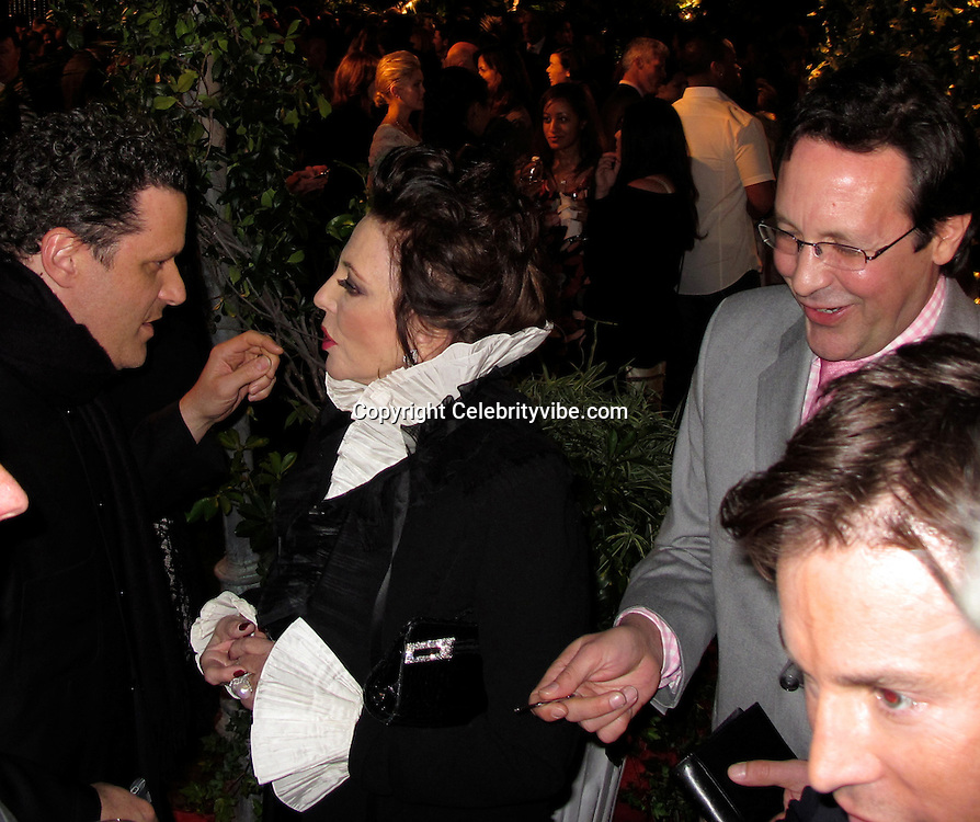 Isaac Mizrahi, Joan Collins and Percy Gibson..QVC Red Carpet Style..Four Seasons Hotel Gardens..Beverly Hills, CA, USA..Friday, March 05, 2010..Photo ByCelebrityVibe.com.To license this image please call (212) 410 5354; or Email:CelebrityVibe@gmail.com ;.website: www.CelebrityVibe.com..