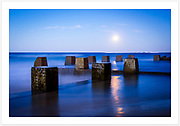 Long exposure at Ross Jones Memorial Pool as a full moon rises [Coogee, NSW, Australia]<br />