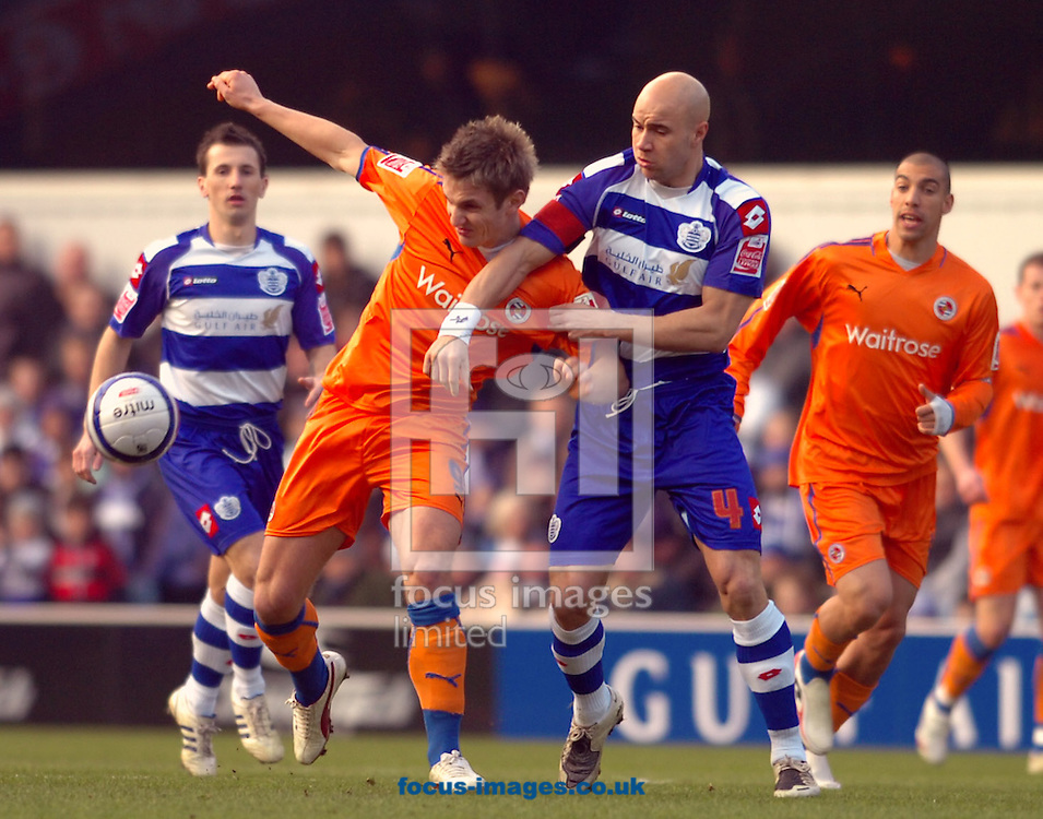 London - Saturday January 31st, 2009: Gavin Mahon of QPR in action against Kevin Doyle of Reading during the Coca Cola Championship match at Loftus Road, London. (Pic by Focus Images)