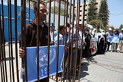May 9, 2017 - Gaza, gaza strip, Palestine - Palestinians hold up  cooking pots  during a sit-in held to show solidarity with Palestinian prisoners on hunger strike in Israeli Jails,In front of the UN headquarters in Gaza City, on May 9, 2017. More than 1,500 Palestinian prisoners from across the political spectrum have pledged to join a hunger strike led by imprisoned Fatah leader Marwan Barghouti, who started his hunger strike on 17 April 2017. (Credit Image: © Majdi Fathi/NurPhoto via ZUMA Press)