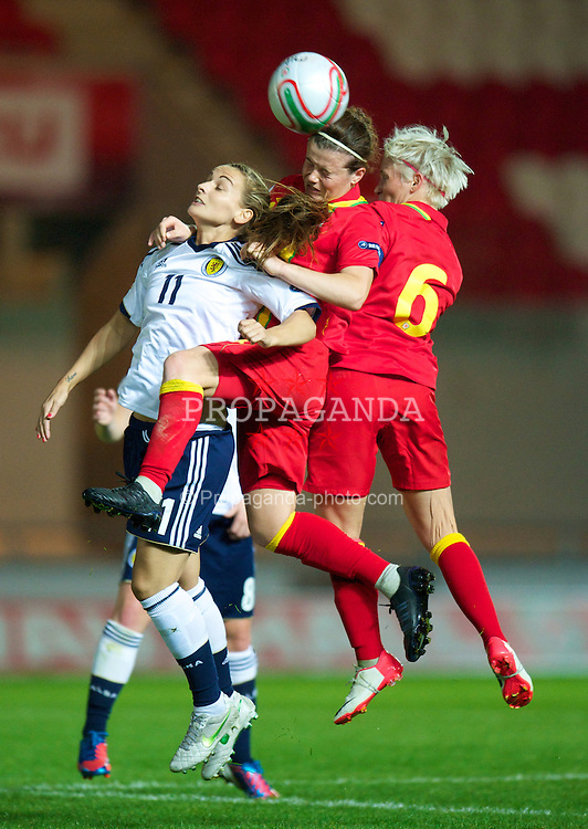 LLANELLI, WALES - Saturday, September 15, 2012: Wales' captain Jessica Fishlock and Hayley Ladd in action against Scotland's Suzanne Grant during the UEFA Women's Euro 2013 Qualifying Group 4 match at Parc y Scarlets. (Pic by David Rawcliffe/Propaganda)