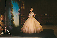 Tatianna Mu&Ograve;oz poses for a portrait for her quincea&Ograve;era at Club Ki Yowga in East Chicago, Indiana.<br /> <br /> --<br /> <br /> American industry disproportionately affects the health of minority and low-income communities. East Chicago, Ind. &oacute; once the country&iacute;s &igrave;most industrialized municipality&icirc; &oacute; offers a view of environmental injustices emerging throughout the Rust Belt.&dagger;<br /> <br /> Nearly 80 percent of the city&iacute;s 11 square miles is zoned for heavy industry. Toxic levels of lead, arsenic and other pollutants contaminate water, soil and air.&dagger;<br /> <br /> In July 2016, nearly 1,200 people in the West Calumet neighborhood learned that children had blood-lead levels six times the Center for Disease Control&iacute;s recommendation for intervention. As mandated, residents began to move, but some remain as they struggle to find housing in the city of 29,000.&dagger;<br /> <br /> &igrave;We feel like we're just being thrown out,&icirc; Nayesa Walker said. Her 3-year-old daughter&iacute;s blood tested high for lead.&dagger;<br /> <br /> In a letter to residents, East Chicago Mayor Anthony Copeland wrote, &igrave;your health and safety are my first priority,&icirc; but many say they cannot trust the government for basic services. Recently, the Environmental Protection Agency announced some of the city&iacute;s drinking water also contains high levels of lead, prompting Indiana Gov. Eric Holcomb to declare a disaster emergency for the Superfund site just south of West Calumet.&dagger;<br /> <br /> Two miles north, the century-old Marktown neighborhood is vanishing. British Petroleum is buying and demolishing the homes surrounding its oil refinery.&dagger;<br /> <br /> &quot;How much money will replace 56 years' worth of memories?&quot; life-long resident Kim Rodriguez asked. &quot;I am rich in history here.&icirc;&dagger;<br /> <br /> The refinery outside Marktown also pollutes the air and nearby Lake 