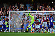 Chelsea goalkeeper Thibaut Courtois (13) clears the goal during the Premier League match between Chelsea and West Ham United at Stamford Bridge, London, England on 15 August 2016. Photo by Jon Bromley.