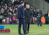 Football - 2016 / 2017 Premier League - West Ham United vs. Manchester United<br /> <br /> Manchester United Manager Jose Mourinho gives a wry smile in the directiion of West Ham Manager Slaven Bilic after the ball bounces across the West Ham goal line at The London Stadium.<br /> <br /> COLORSPORT/DANIEL BEARHAM