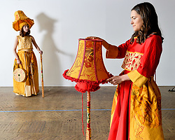 Pictured: Liberty Bramall (light) and Kate Campbell wearing lampshade outfits designed by Liberty Bramall.<br /> <br /> Edinburgh College of Art students held a photo call before their degree show.<br /> <br /> © Dave Johnston / EEm