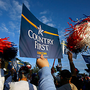 PT_296920_ALLE_Palin_02.WILLIE J. ALLEN JR.  |   Times.(11/01/2008 New Port Richey).Sarah Palin supporters wave their Country First  signs at the Sims Park in New Port Richey on Saturday morning.(WILLIE J. ALLEN JR.   |   Times)