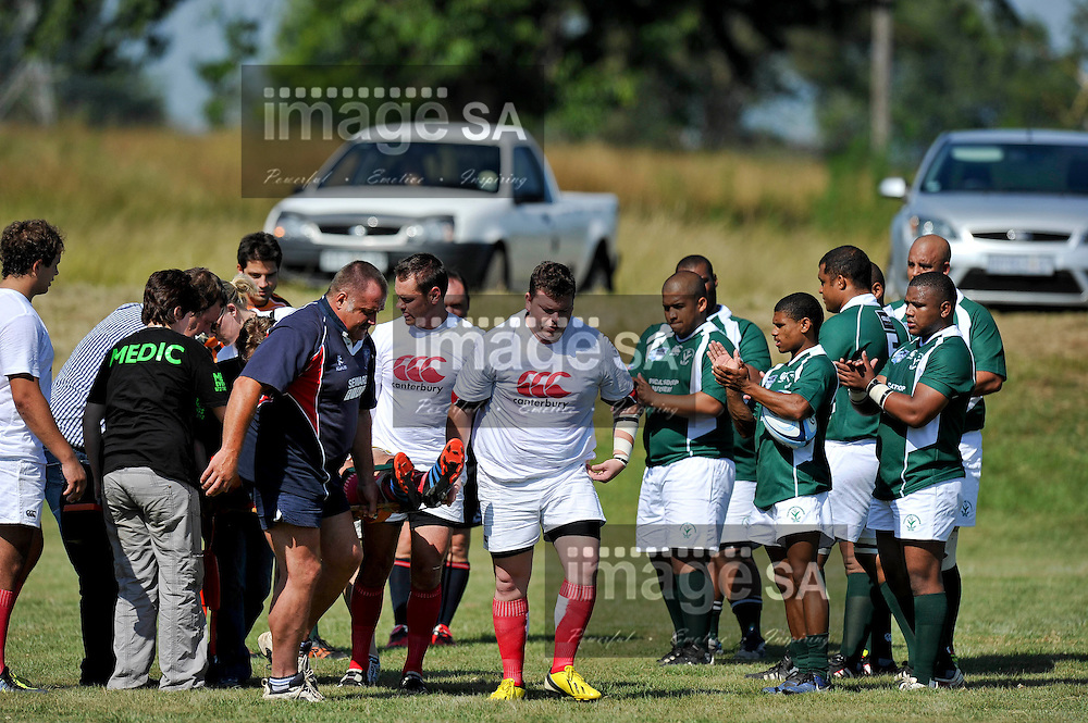 WHITE RIVER, SOUTH AFRICA - SATURDAY FEBRUARY 23 2013,  Francois Barnard being carried off the filed during match 16 of the Cell C Community Cup rugby match between White River and Evergreens from George held at the White River Rugby Club, White River, Mpumalanga .Photo by ImageSA