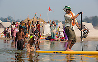 Jeremiah gets a push from a kid who is lathered up for his morning bath in the Ganga.