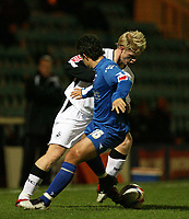 Photo: Rich Eaton.<br /> <br /> Peterborough United v Swansea City. Johnstone's Paint Trophy. 31/10/2006. ALan Tate at rear of Swansea tries to turn inside Boros Danny Crow #16