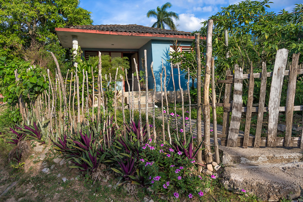 House and fence in Charco Redondo, Granma, Cuba.