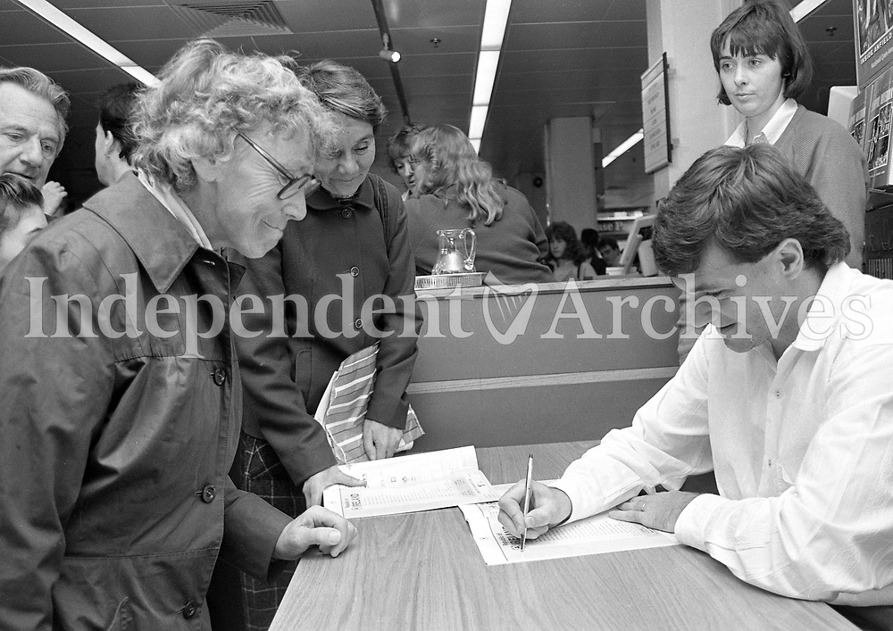Irish International Football Star Ray Haughton signing his book at Easons in O'Connell Street, Dublin, circa October 1989 (Part of the Independent Newspapers Ireland/NLI Collection).
