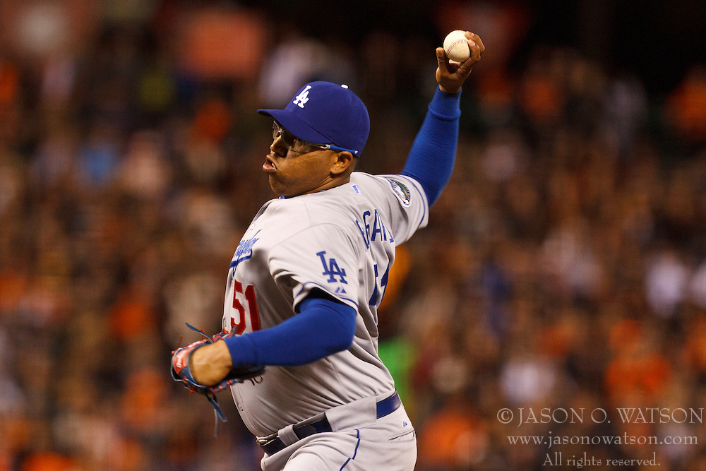 SAN FRANCISCO, CA - JULY 27: Ronald Belisario #51 of the Los Angeles Dodgers pitches against the San Francisco Giants during the eighth inning at AT&T Park on July 27, 2012 in San Francisco, California. The Los Angeles Dodgers defeated the San Francisco Giants 5-3 in 10 innings. (Photo by Jason O. Watson/Getty Images) *** Local Caption *** Ronald Belisario