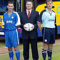 St Johnstone launch new strip and new sponsor 04.07.02<br />New signings John Robertson (left) models the new home strip alongside Ian Maxwell modelling the new away strip pictured with Neil Wood, Managing Director of new sponsors Citylink<br />see story by Gordon Bannerman Tel: 01738 493213 or contact Charles Mann on 0131 558 3111<br /><br />Picture by Graeme Hart.<br />Copyright Perthshire Picture Agency<br />Tel: 01738 623350  Mobile: 07990 594431