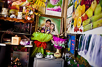 A wedding photo is framed in a family home in Lao Cai, Vietnam, near the China border.