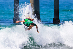Dion Atkinson (AUS) advances to Round 4 of the VANS US Open of Surfing after winning Heat 4 of Round 3 at Huntington Beach, CA, USA.