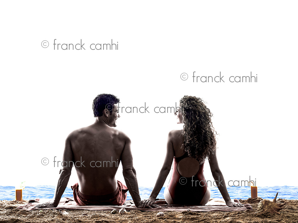 one caucasian couple man and woman on the beach sitting rear view silhouette isolated on white background