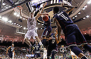SOUTH BEND, IN - JANUARY 12: Jack Cooley #45 of the Notre Dame Fighting Irish and Enosch Wolf #1 of the Connecticut Huskies battle for a rebound as Shabazz Napier #13 of the Connecticut Huskies and Ryan Boatright #11 of the Connecticut Huskies look on at Purcel Pavilion on January 12, 2012 in South Bend, Indiana. Connecticut defeated Notre Dame 65-58. (Photo by Michael Hickey/Getty Images) *** Local Caption *** Jack Cooley; Enosch Wolf; Shabazz Napier; Ryan Boatright