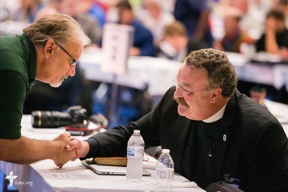 Hans Hargens greets the Rev. Dr. Matthew C. Harrison, president of The Lutheran Church–Missouri Synod, following Harrison's presentation at the 54th Convention of the South Wisconsin District on Tuesday, June 9, 2015, at Concordia University Wisconsin in Mequon, Wis. LCMS Communications/Erik M. Lunsford