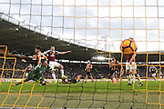 Burnley FC defender Michael Keane (5)  scores goal to go 1-1 during the Premier League match between Hull City and Burnley at the KCOM Stadium, Kingston upon Hull, England on 25 February 2017. Photo by Ian Lyall.