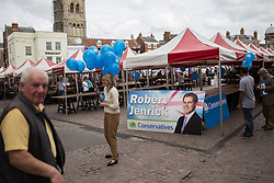 © Licensed to London News Pictures . 02/06/2014 . Newark , Nottinghamshire , UK . Conservative Party campaigners with candidate , Robert Jenrick , campaign materials in Market Square , Newark , today (Monday 2nd June 2014), ahead of the by-election due to take place on Thursday (5th June 2014) . Photo credit : Joel Goodman/LNP