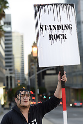 December 3, 2016 - Los Angeles, California, United States - Native American activist, Lance Browneyes, holds a sign during a protest against the Dakota Access Pipeline on December 3, 2016 in Los Angeles, California. Protesters gathered in solidarity with the Sioux tribe in their efforts to stop the construction of the oil pipeline.   ...Native American activist, Toyah Browneyes, holds a sign during a protest against the Dakota Access Pipeline on December 3, 2016 in Los Angeles, California. Protesters gathered in solidarity with the Sioux tribe in their efforts to stop the construction of the oil pipeline. (Credit Image: © Ronen Tivony/NurPhoto via ZUMA Press)