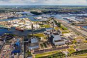 Nederland, Noord-Holland, Amsterdam, 14-06-2012; Westpoort, Nieuwe Hemweg met centrales van Nuon. Centrale Hemweg 8 met schoorsteen met witte bies is kolengestookt, Centrale Hemweg 7 is gasgestookt. Het blauwe gebouw is de  nieuwe gasgestookte centrale Hemweg 9, nog in aanbouw. .In de achtergrond de Petroleumhaven met daarnaast de Coentunnel en de 2e Coentunnel in aanbouw. .View on Westpoort (port, industrial and office area) in the western harbour area of Amsterdam, with oil storage, the Nuon power plant and North Sea Canal..luchtfoto (toeslag), aerial photo (additional fee required).foto/photo Siebe Swart