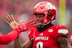 Louisville quarterback Lamar Jackson congratulates wide receiver Reggie Bonnafon after a touchdown in the first half. The University of Louisville hosted Kentucky, Saturday, Nov. 26, 2016 at Papa John's Cardinal Stadium in Louisville. Kentucky won the game 41-38.