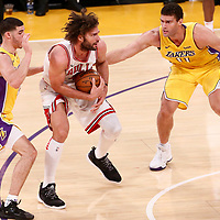 21 November 2017: Chicago Bulls center Robin Lopez (42) drives past Los Angeles Lakers center Brook Lopez (11) and Los Angeles Lakers guard Lonzo Ball (2) during the LA Lakers 103-94 victory over the Chicago Bulls, at the Staples Center, Los Angeles, California, USA.