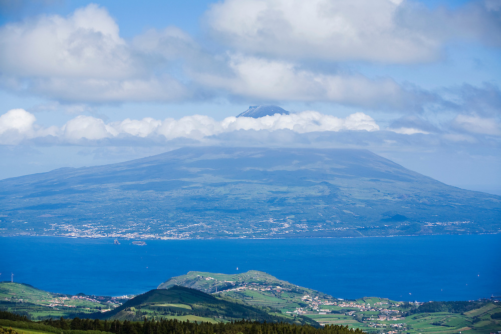 A view from the top of the Caldera atop the island of Faial. In the distance is the neighboring island of Pico. The Azores are a group of islands under Portuguese sovereignty. They Mark the most westerly point of the E.U. and earn most of their income from agriculture and tourism.