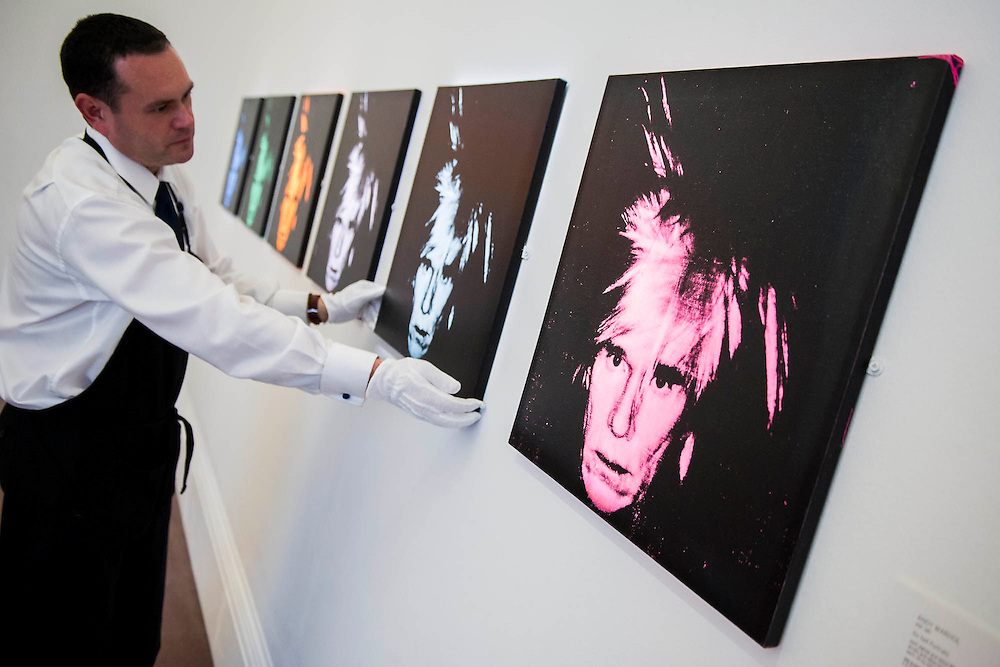 """Sotheby's London Exhibition of Sale Highlights from the Forthcoming Major New York Auctions of Contemporary and Impressionist and Modern Art, including exceptional Diamonds from Geneva. The auctions will include: $25-35 million masterpiece by Gerhard Richter; Andy Warhol - Six Self Portraits $25-35m (pictured); a Giacometti sculpture; The """"Graff Vivid Yellow""""  -  At 100.09 carats, one of the rarest yellow diamonds of its size (est. $15-25 million); The Victory Diamond - A 31.34-carat diamond named to commemorate the Allied Victory in World War II ($5-8 million); and one of the world's largest known round brilliant-cut diamonds weighing 103.46 carats (est. $3.5-5 million). They will take place in New York and Geneva 11-15 April 2014. Sotheby's, New Bond St, London, UK."""